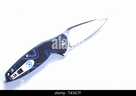 Knife in the unfolded form. Knife with a clip on the handle. Pocket knife. - Stock Photo
