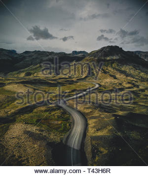 aerial photography of mountains under cloudy sky - Stock Photo