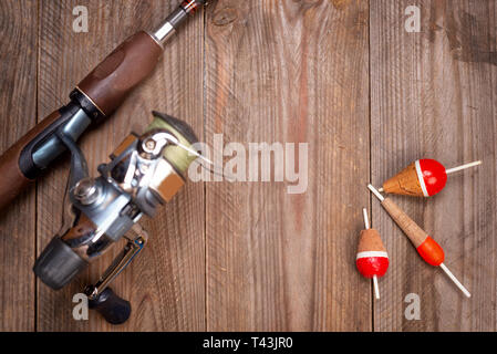 Fishing tackle on wooden background. Accesories for fishing with copyspace . - Stock Photo