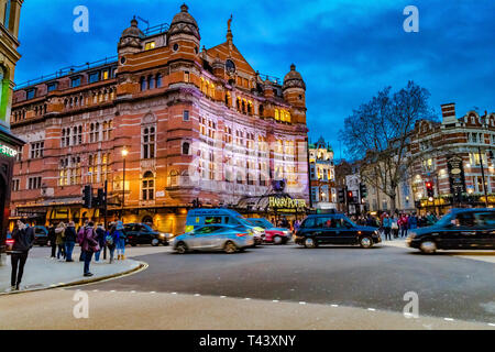 Traffic and people outside The Palace Theatre on Shaftesbury Avenue ,currently the home of Harry Potter and the Cursed Child stage play - Stock Photo
