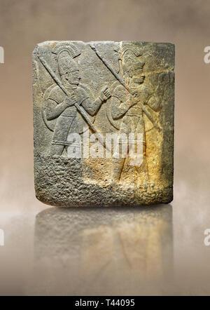 Hittite relief sculpted orthostat stone panel of Herald's Wall. Limestone, Karkamıs, (Kargamıs), Carchemish (Karkemish), 900-700 B.C. Military parade. - Stock Photo