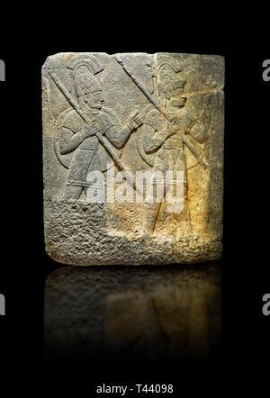 Photo of Hittite relief sculpted orthostat stone panel of Herald's Wall. Limestone, Karkamıs, (Kargamıs), Carchemish (Karkemish), 900-700 B.C. Militar - Stock Photo