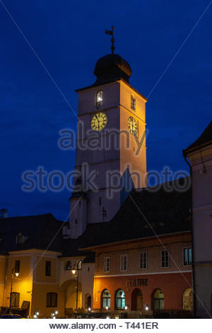 The Clock Tower of Cisnădiei Gate is Lit Up During Blue Hour - Sibiu, Romania - Stock Photo