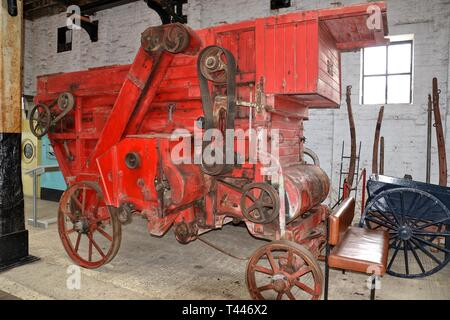 A thresher or thrasher at the Long Shop Museum, Leiston, Suffolk, UK - Stock Photo