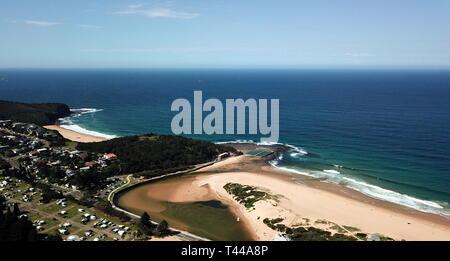 Aerial view of Narrabeen Lagoon, North Narrabeen Rockpool and Turimetta beach. Coast of Tasman sea in Sydney.