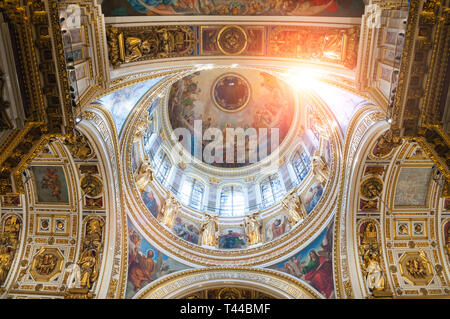 SAINT PETERSBURG, RUSSIA - AUGUST 15, 2017. Ceiling ornated with sculptures and Bible paintings in the interior of the St Isaac's Cathedral in Saint P - Stock Photo
