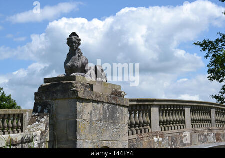 Sphinx on the Bridge at Compton Verney House, Compton Verney, Kineton, Warwickshire, England, UK. 18th century Country Mansion and Art Gallery - Stock Photo