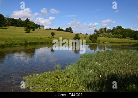 The River at Compton Verney House, Compton Verney, Kineton, Warwickshire, England UK. 18th century Country Mansion & Art Gallery.  Landscaped grounds. - Stock Photo
