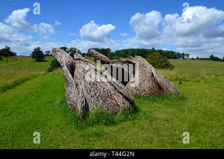 Sculptures made from plant fibres woven together to create a wave effect. Compton Verney House, Compton Verney, Kineton, Warwickshire, England, UK. - Stock Photo