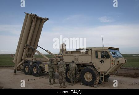 U.S. Army soldiers from Bravo Battery, 2nd Air Defense Artillery Regiment, 11th Air Defense Artillery Brigade, perform equipment checks on a Terminal High Altitude Area Defense launching station in Israel, March 4, 2019.   The deployment of a THAAD System to Israel is an exercise involving U.S. Army, U.S. Air Force and Israeli forces, under the Dynamic Force Employment concept. The exercise builds readiness and interoperability in the region, demonstrates the U.S. capability to rapidly deploy air defense assets globally, and demonstrates U.S. Army Europe's mission to deter potential adversarie - Stock Photo
