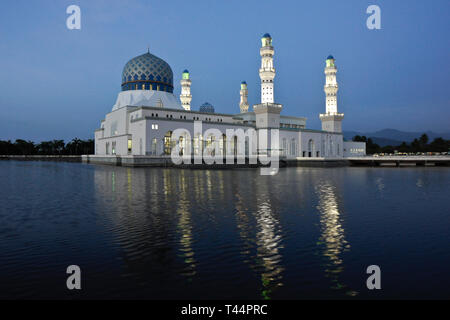 City Mosque on Likas Bay lighted at dusk, Kota Kinabalu, Sabah (Borneo), Malaysia - Stock Photo