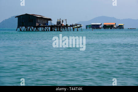 Dwellings built on stilts in South China Sea near Kota Kinabalu, Sabah (Borneo), Malaysia - Stock Photo