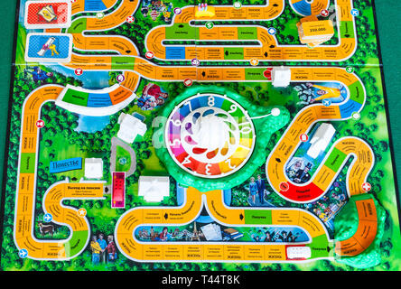 MOSCOW, RUSSIA - APRIL 3, 2019: gameboard of The Game of Life board game. This board game was created in 1860 by Milton Bradley, the modern version wa - Stock Photo