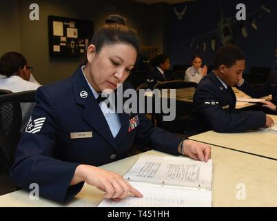 U.S. Air Force Tech. Sgt. Barbara Kruse, 334th Training Squadron student, reviews aviation resource management apprentice course study material inside Wolfe Hall at Keesler Air Force Base, Mississippi, Feb. 26, 2019. Kruse graduated with perfect scores throughout the course. After graduation she will return to the 170th Operations Support Squadron as an aviation resource manager, Nebraska Air National Guard, at Offutt Air Force Base, Nebraska. 'There is a lot of information 1CO's are responsible for inputting and auditing, and the tiniest of errors has the potential to affect an aircrew member - Stock Photo