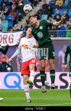 Leipzig, Germany. 13th Apr, 2019. Wolfsburg's Robin Knoche (R) vies for header with Leipzig's Lukas Klostermann during a German Bundesliga match between RB Leipzig and VfL Wolfsburg in Leipzig, Germany, on April 13, 2019. Leipzig won 2-0. (Xinhua/Kevin Voigt) Credit: Kevin Voigt/Xinhua/Alamy Live News - Stock Photo