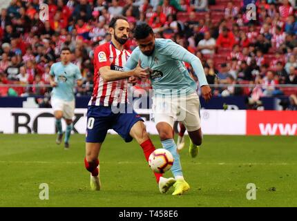 Madrid, Spain. 13th Apr, 2019. Atletico Madrid's Juanfran Torres (L) and Celta's Sofiane Boufal compete during a Spanish league match between Atletico Madrid and Celta de Vigo in Madrid, Spain, on April 13, 2019. Atletico Madrid won 2-0. Credit: Edward F. Peters/Xinhua/Alamy Live News - Stock Photo