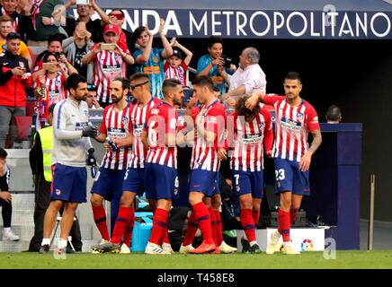 Madrid, Spain. 13th Apr, 2019. Players of Atletico Madrid celebrate a goal during a Spanish league match between Atletico Madrid and Celta de Vigo in Madrid, Spain, on April 13, 2019. Atletico Madrid won 2-0. Credit: Edward F. Peters/Xinhua/Alamy Live News - Stock Photo