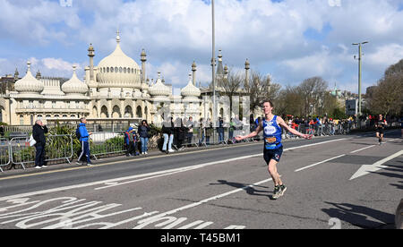 Brighton, Sussex, UK. 14th Apr, 2019. Early runners pass by the Royal Pavilion as they take part in this years Brighton Marathon which is celebrating its 10th anniversary Credit: Simon Dack/Alamy Live News - Stock Photo