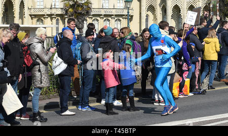 Brighton, Sussex, UK. 14th Apr, 2019. Thousands of runners and spectators take part in this years Brighton Marathon which is celebrating its 10th anniversary Credit: Simon Dack/Alamy Live News - Stock Photo