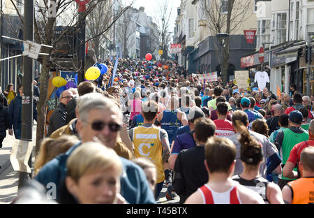 Brighton, Sussex, UK. 14th Apr, 2019. Thousands of runners and spectators in the narrow St James's Street area of Brighton take part in this years Brighton Marathon which is celebrating its 10th anniversary Credit: Simon Dack/Alamy Live News - Stock Photo