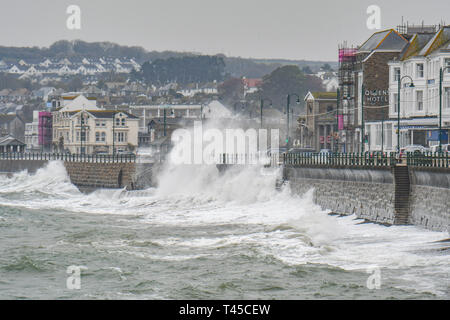 Penzance, Cornwall, UK. 14th April 2019. UK Weather.  The second week of the school holidays started with rain, strong easterly wind and big waves smashing into the seafront at Penzance today. Credit: Simon Maycock/Alamy Live News - Stock Photo