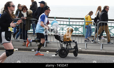 Brighton UK 14th April 2019 -   Thousands of runners some in fancy dress take part in this years Brighton Marathon which is celebrating its 10th anniversary Credit: Simon Dack/Alamy Live News - Stock Photo