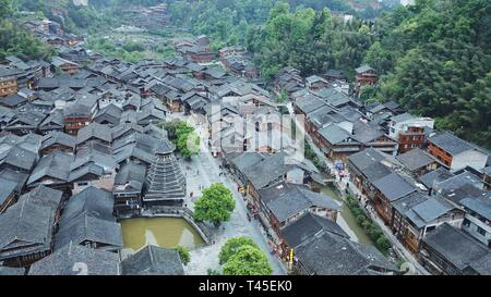 Liping, China. 14th Apr, 2019. Aerial photo taken on April 14, 2019 shows the Dong village of Zhaoxing, Liping County, southwest China's Guizhou Province. Credit: Ou Dongqu/Xinhua/Alamy Live News - Stock Photo