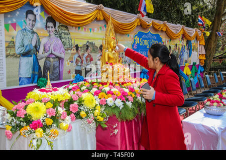 Wimbledon, UK. 14th Apr, 2019. Thai community in London  celebrate  this year's Songkran festival,at the Thai temple in Wimbledon , the festival  also known as the Buddhist New Year .Songkran is often referred to as the biggest water fight in the world.The holiday was traditionally marked by visiting family members and pouring water over Buddha statues.Traditional Thai dancing ,the temple was visited by thousands who come to enjoy ,but without the traditional poring of water to anybody near by@Paul Quezada-Neiman/Alamy Live News - Stock Photo