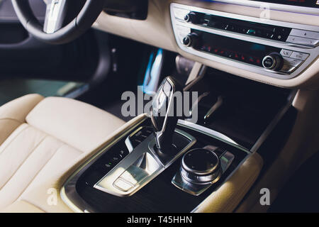 Car luxury inside. Interior of prestige modern car. Front seats with steering wheel. White cockpit. - Stock Photo