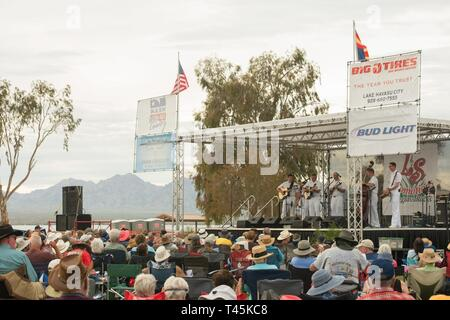 "LAKE HAVASU CITY,  Arizona (March 1, 2019)  Members of the U.S. Navy Band Country Current perform at the Lake Havasu ""Bluegrass on the Beach"" bluegrass festival. The Navy Band performs all across the country providing an opportunity for communities to connect with Sailors and going where ships can't go to forge strong and capable partnerships for a stronger America. - Stock Photo"