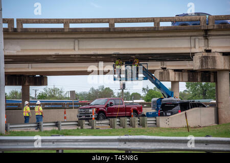 BOSSIER CITY, LA., U.S.A. - APRIL 12, 2019: Workers inspect an aging overpass on U.S. Interstate Highway 20. - Stock Photo
