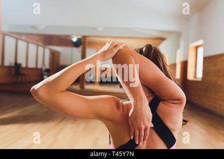 woman practices yoga at indoor studio homer alaska stock