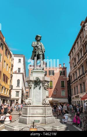 Vintage Statue of Carlo Goldoni under the summer sun Campo San Bartolomeo Venice Veneto Italy Europe EU. - Stock Photo