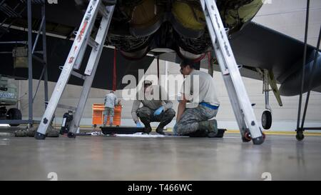 Airmen from the 2nd Maintenance Group work on a B-52 Stratofortress during a phase inspection at Barksdale Air Force Base, La., March 4, 2019. The phase inspection of the B-52 Stratofortress involved more than 20 Air Force Specialty Codes from the Maintenance Group and supporting agencies. - Stock Photo