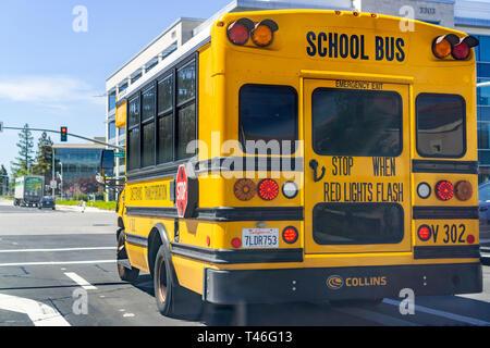 April 12, 2019 Santa Clara / CA / USA - School Bus waiting at a traffic junction in South San Francisco bay area - Stock Photo