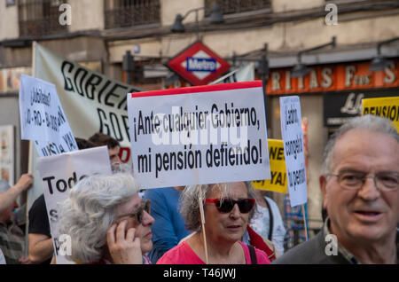 A woman is seen holding a placard that says No matter who wins the elections, I defend my pension during the protest. Hundreds of people in Madrid protested against cuts in pensions in the context of the upcoming Spanish elections of April the 28th. - Stock Photo