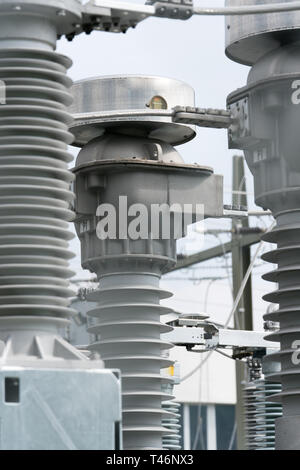 A detail view of transformers and conduits at an electric power station - Stock Photo