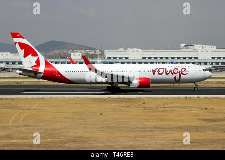 An Air Canada Rouge Boeing 767-300ER on the Runway of the Athens' international airport. - Stock Photo