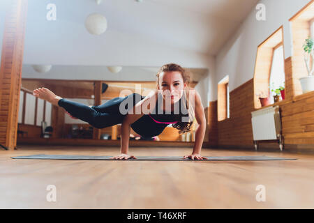 woman standing in crane exercise stock photo 129651513