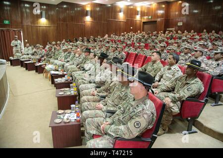 U.S. Army and Jordan Armed Forces soldiers attend the JAF 10th Border Guard Force Battalion's graduation ceremony, March 14, 2019, Peace Operations Training Center near Amman, Jordan. The 10th BGF Battalion graduated from the Joint Operational Engagement Program where they trained with the California Army National Guard's 1st Squadron, 18th Cavalry Regiment for ten weeks to enhance the BGF readiness to protect and secure Jordan's borders. (Army National Guard - Stock Photo