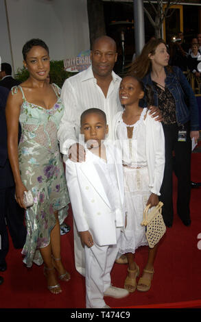 LOS ANGELES, CA. June 03, 2003: Director JOHN SINGLETON & family at the world premiere of 2 Fast 2 Furious at the Universal Amphitheatre, Hollywood. - Stock Photo