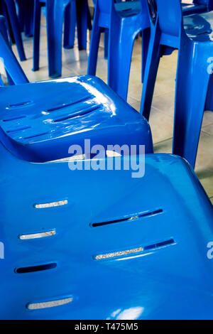 texture and vivid Blue color of plastic chair - Stock Photo