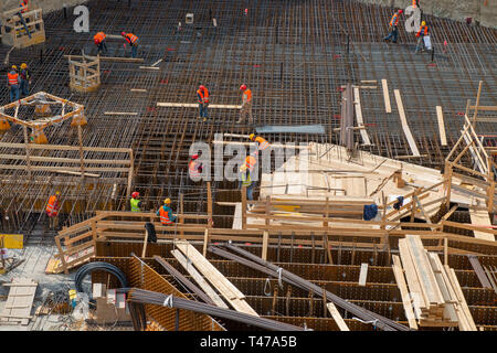 MILAN, ITALY 10 APRIL, 2019: workers at work for the construction of the reinforced concrete base in the new business district in the island district - Stock Photo