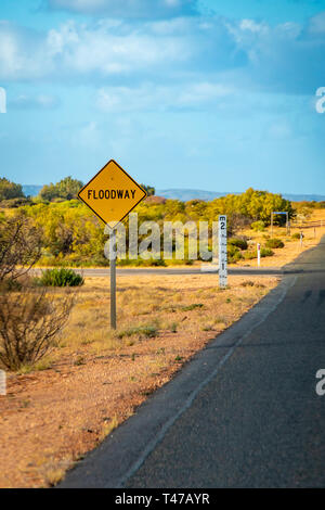 Yellow Flood way street sign in Australian Outback - Stock Photo