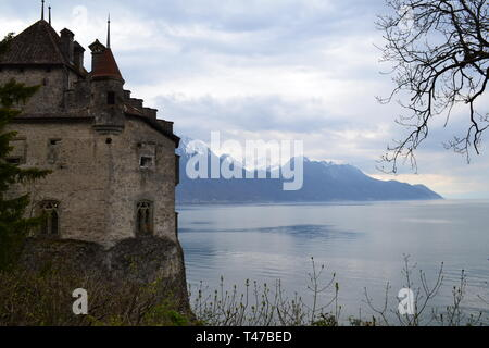 Medieval Chillon Castle, Montreux, Switzerland on a cloudy day in Spring (April) on beautiful Lake Geneva - Stock Photo
