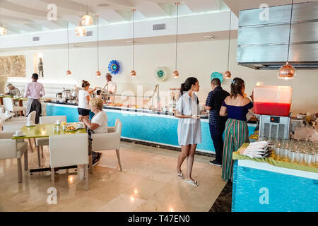 Cartagena Colombia El Laguito Hotel Dann Cartagena hotel free included breakfast buffet guests restaurant woman man inside - Stock Photo