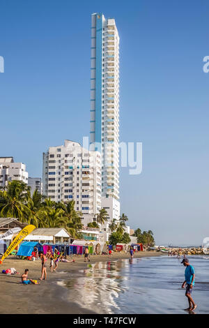 Cartagena Colombia El Laguito apartment building high rise tall thin waterfront beach sand water - Stock Photo