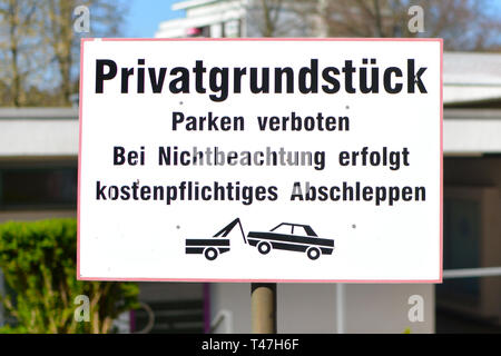 Sign at parking lot saying in German: 'Private property. Parking prohibited. Vehicles towed away at the owner's expense' - Stock Photo