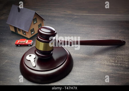 Real Estate Law concept. Model of house and justice gavel. - Stock Photo