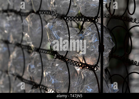 many plastic bottle on metal rusted grid - Stock Photo